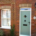 PVCu front door pale green front of house