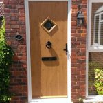 PVCu front door brown diamond panel